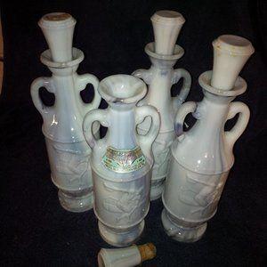 4 Vintage Slag Glass Whiskey Bottles